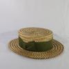 Joli chapeau ancien en osier cerclé d'un tissus vert T53