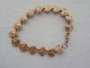Bracelet de petits cœurs dorés