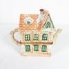 Théière en forme de maison en porcelaine