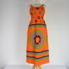 Robe à fleurs de style années 1970 de couleur orange taille S