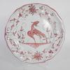 Assiette Moustier décor rose et oiseau
