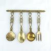 Couverts décoratifs en laiton doré