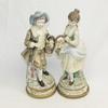 2 statues en biscuit (céramique)
