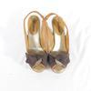 Sandale compensée en toile enduite beige