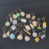 Lot de 26 Porte clef vintage publicitaire années 60s