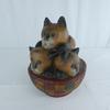 Trio de chats en bois sculptés