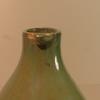 Pichet à huile en terre cuite vernie vert céladon.