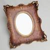 Miroir ovale dans son cadre en bois doré