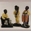 Lot de 3 statuettes d'instrumentistes