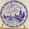 Grand plat faïence bleue décor canal et moulins Hollande