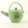 Petite théière verte décor fleurs en faïence artisanale