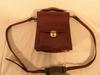 Sac/ Pochette en cuir porté en bandoulière