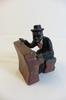 Statuette d'un homme jouant du piano