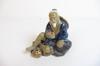 Statuette d'un vieille homme asiatique en résine