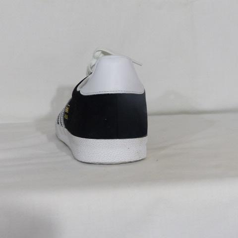 Chaussures Adidas noir avec ses trois bandes blanches taille 41