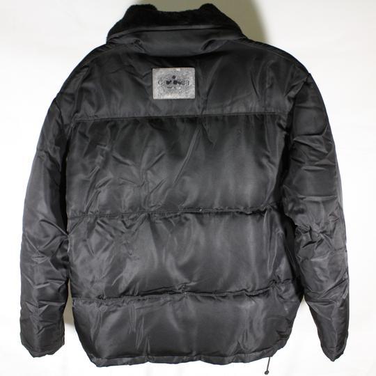 Doudoune femme noire Gucci taille 42 sur Label Emmaüs, boutique en ... f47740d46d3